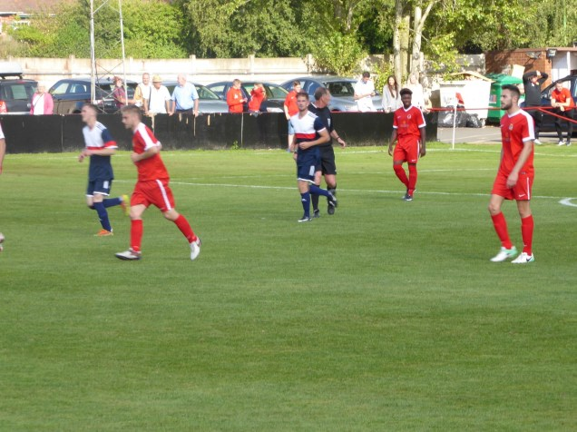 Littleton hurry to get on with game after scoring their first goal, in the second half.