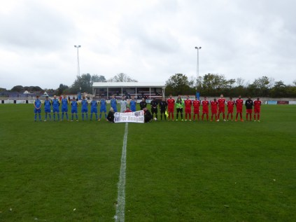 The pre-match line up paused for a one minute silence and respect, fully observed by all present.