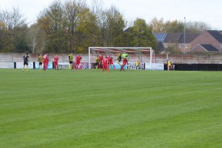 The FA vase match begins in earnest. Holbeach in their black and yellow shirts attack the Wood goal