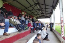 Attentive spectators sat sitting in the stand.