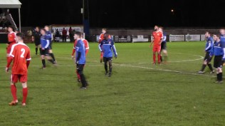 Second half and positive play, determination and concentration are evident as players prepare to receive a kick from the Wood's goalkeeper