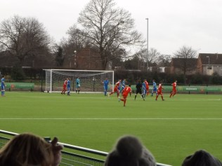 Early in the first half and first goal to the Wood. All players had to contend with the wind today, as did spectators, especially after the second glass.