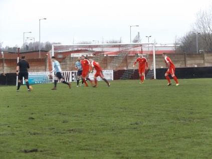 Still first half and Coventry power their way towards the Wood goalmouth, leaving imprints of the surface as they do.