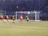 Second half goalmouth action, as darkness falls.