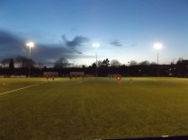 In the bleak mid-winter. Paget Rangers are playing Walsall Wood in the afterglow of the setting sun. Cold, very cold for the spectators, but a hot contest for the players.