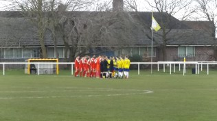 There, in the distance, the two teams shook hands before the match. Uttoxeter played in yellow