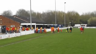 The two teams emerge. Warwick played in yellow shirts. A super contest was about to unfold.