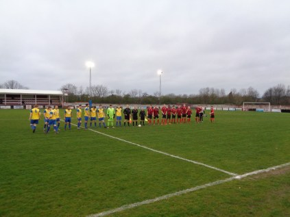 The teams line up before the start of the game. Pelsall Villa played in red and Black shirts