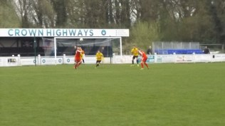 Three Warwick players take on one Wood player to defend their goalmouth. First half