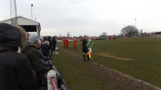 First half just before half time. Players pause and waist. A Brocton defender had landed awkwardly and receives attention from trainers of both teams. An anxious moment for all.