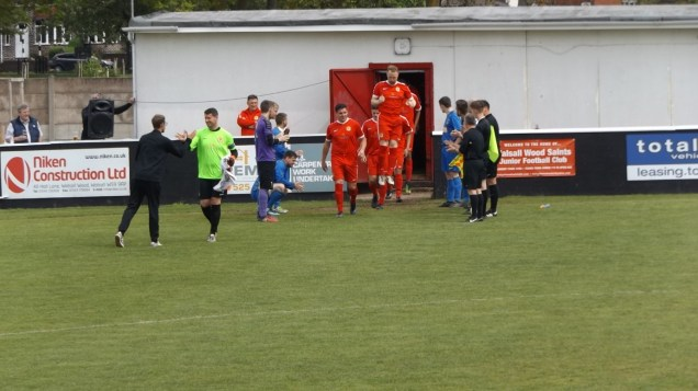 Bolehall Swifts and the officials honour Walsall Wood by applauding them on to the field. That's a fine gesture, appreciated by all the spectators.