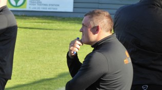 Later in the second half and the Wood's manager is deep in thought, briefly.