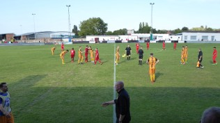 The referee blows his whistle to signal the end of a thrilling fast game of positive soccer. Applause and respect.