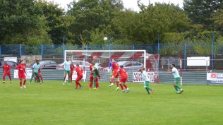 One of Coventry's very tall forwards take up position as they attack the Wood goal, again