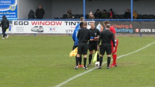 Customary handshake by captains with the match officials