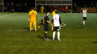 Second half and one of the several moments where the ref has to have a word. Then on with the game.