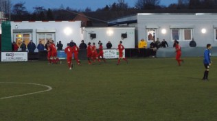 Second half and Joey Butlin's millimetre accurate long range free kick has broken the impasse and the Men in all red , socks included, rejoice. The game has come alight. How will the sporting visitors respond?