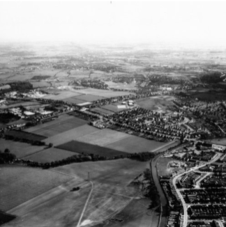 Took me a while, this one: Home Farm at Sanhills/Catshill. Looking along the canal towards Shire Oak. Chester Road runs horizontally across the image.