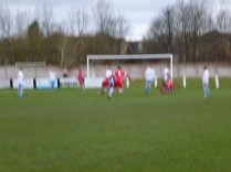 Third goal to the Wood ,in a blur of action