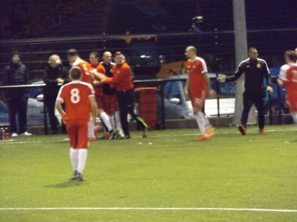 And the Wood's subs players congratulate the scorer. That's team spirit!