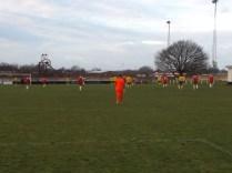 Distant soccer action. So far