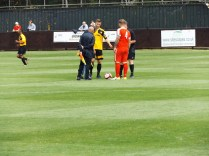 The game got under way with substitute officials for the first half. Unusual but understandable