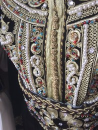 The beads are most frequently used as buttons on kaftans, as in the center here