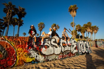 Teen Boys hang out on a wall, Venice Beach, Los Angeles County, California, United States of America