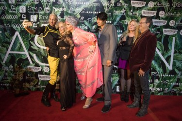 Entertainer Arial Trampway on the red carpet with friends. Palm Springs Fashion Week.