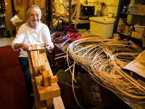 Billie Ruth Sudduth working wood strips for a basket on a shave horse