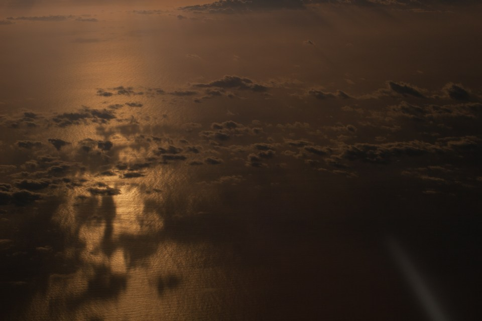 looking down on clouds at sunrise