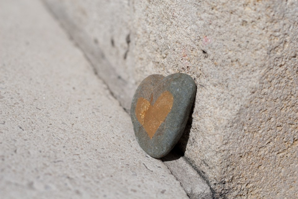 stone shaped heart with golden heart drawn on