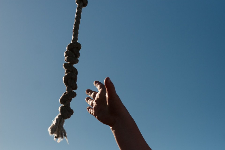 hand reaching for rope