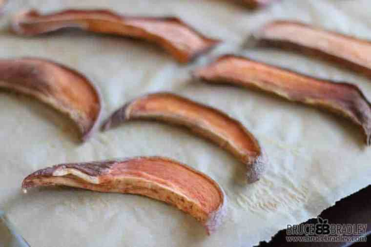Bake your sweet potato strips for 3-4 hours at 250 degrees F to make sweet potato jerky.