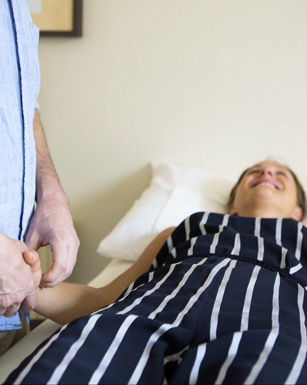 Taking a smiling patient's pulses | Bruce McCallum - five element acupuncture