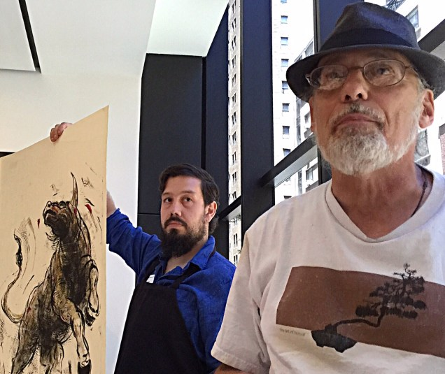 Bruce at MoMA demo with Justin Sanz holding one of Bruce's monotypes.