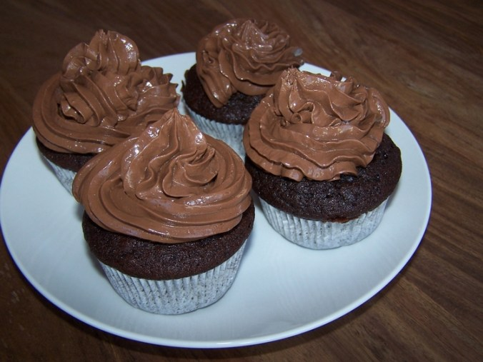 chocolate muffins with chocolate cream topping