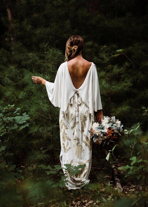 Wijde mouwen bruidsjurk