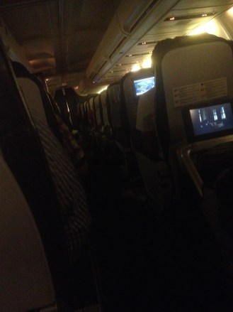 This is an image of the inside of the plane right before landing. It's a tight fit to walk down the center aisle!