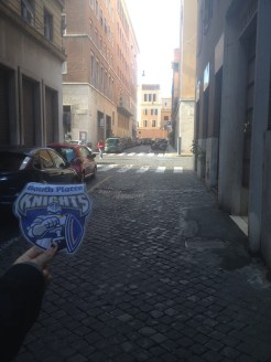 This photo was taken on Sunday, November 15th, just outside our vacation rental doorway. At the end of the street, you can see a tall building. The building is on the outside border of the Vatican City.