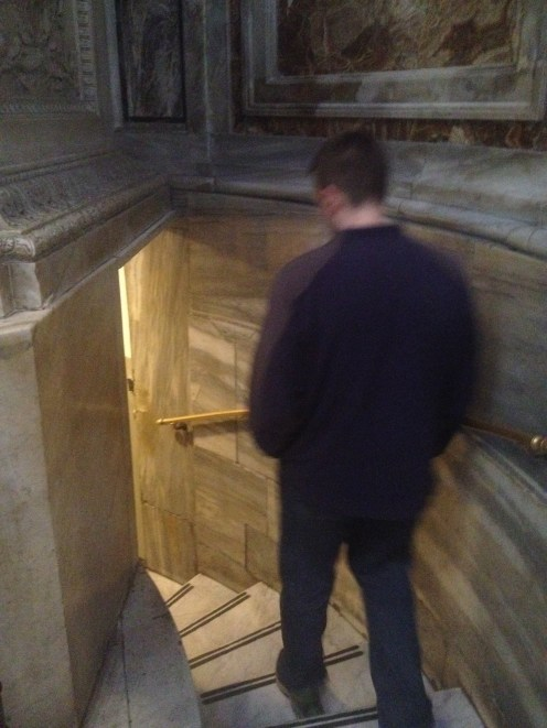 John walks down the stairs into the display below the floor. We weren't allowed to take pictures because it's a sacred space filled with St. Peter's tomb as well as the tombs of popes and various altars for different functions. It was worth seeing though.