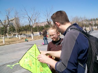 At Yongdingmen Square, people did Tai Chi every morning. One day, we decided to fly kites there.