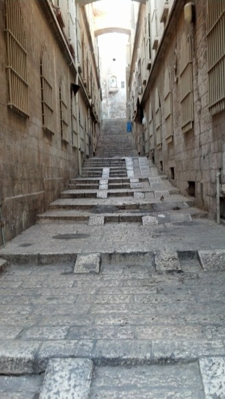 A road leading off into the Old City from the Via Dolorosa.