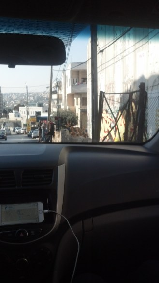 Driving into Bethlehem, Israel. The wall between Israel and Palestine is visible on the right.