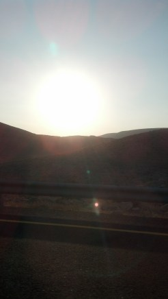 The sun setting behind the desert mountains in Israel.