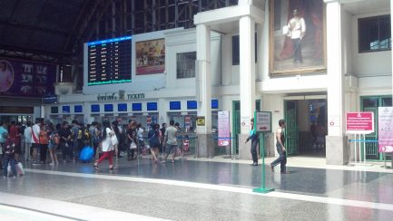 In this photo, people line up to purchase tickets at the various ticketing stations.