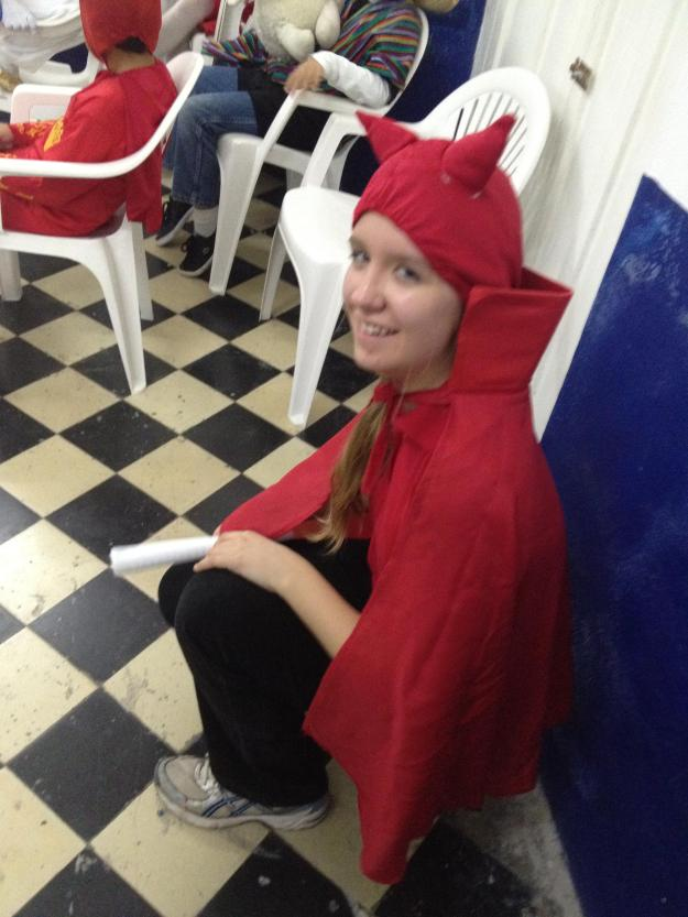 Lydian played along and even wore the dorky devil hat for the Christmas festivities in Progreso.