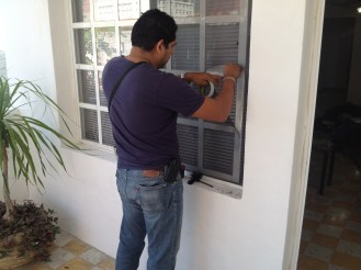 This is a photo of a police officer in Mexico dusting our window for fingerprints after we were robbed.