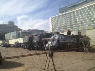 Barbed wire and military tanks in Tahrir Square, just beyond the line leading into the Egyptian Museum.