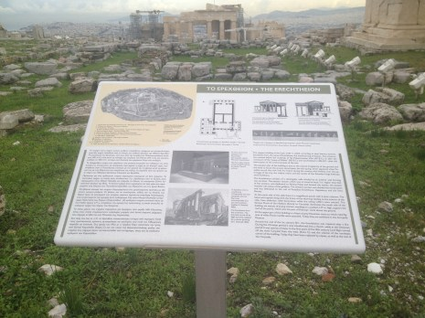 This sign talks about the Erechtheion, a structure situated nearby to the Parthenon at the Acropolis.